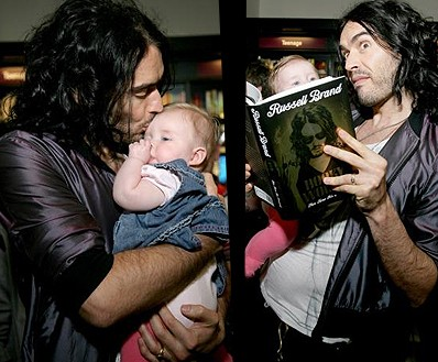 Russell Brand Kisses A Baby At Book Signing In Bristol